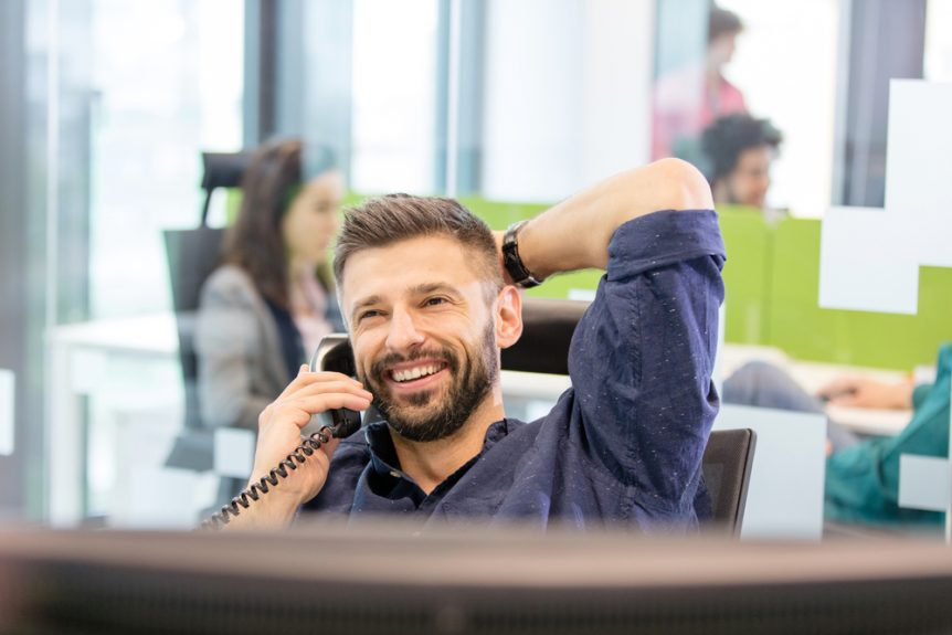 talking loudly on phone in office