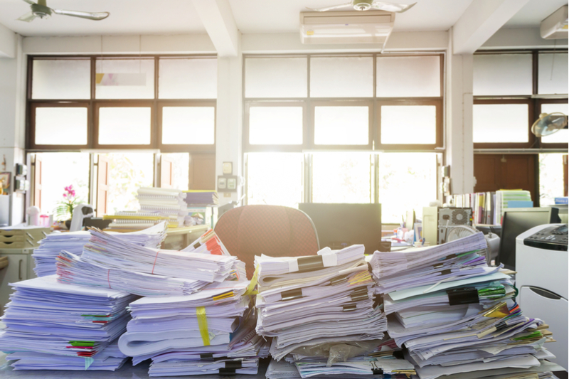 Stacks of paperwork on a desk