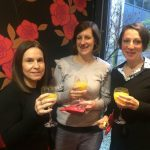 3 ladies witrh OJ at christmas party